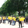 Advocates and Survivors in yellow waiting for the press event to begin.