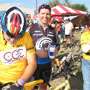 Steve Bartolucci, Brian Dallas, and in the yellow jersey and jeans is Steve's better half - Jeanne.